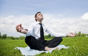 buisnessman do yoga exercise outdoor